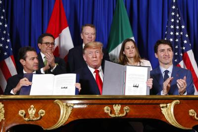 Trump scores political win with signing of new North American trade pact at G-20